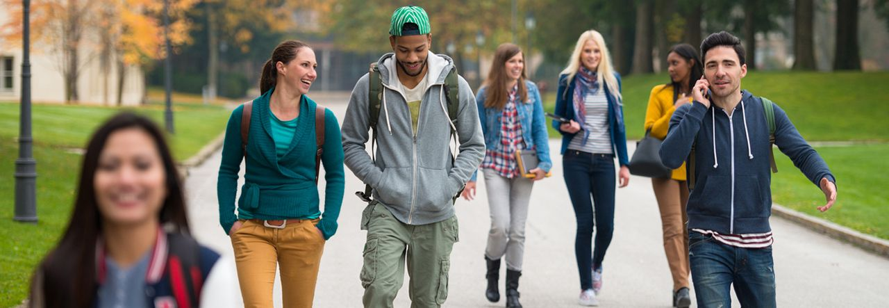 A group of students walking through campus